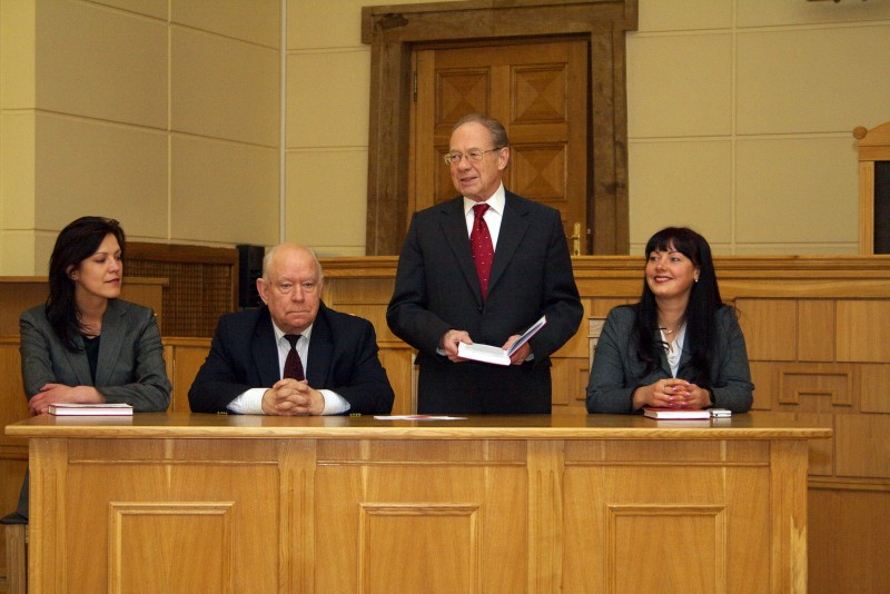 """20.03.2013. Zane Petersone, the acting judge of the Chamber of Civil Cases, the Doctor of Law (the first from the right) gave special contribution to field of Latvian legal literature – her book """"Means of civil legal protection of intellectual property"""", which was developed for nine years on the basis of Doctoral Thesis, is the first book in Latvia about theme of protection of intellectual property. In the event dedicated to the opening of the book in the Supreme Court, words of appreciation to new talented lawyer, judge and author were said by Santa Sausina, the member of the Board of the Court House Agency, which published the book; Gunars Aigars, the Chair of the Chamber of Civil Cases, and the senator, professor Kalvis Torgans, the author of the preface to the book and host of the event."""