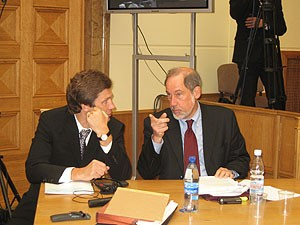 Dr. Andrejs Millers discussing the defense strategy with the defendant Charles Zimmermann