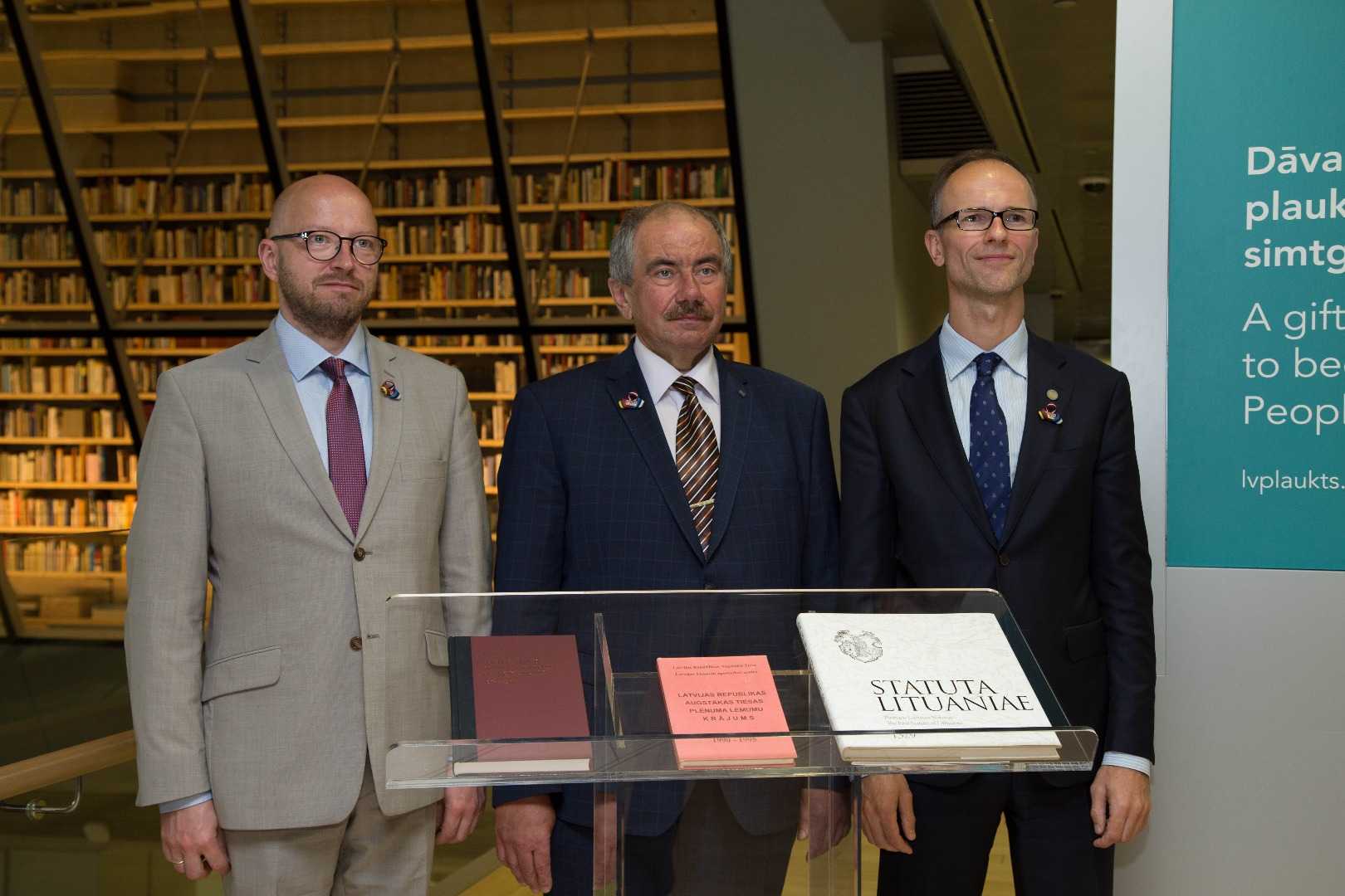 """14.06.2018. Chief Justices of the Supreme Courts of the Baltic States donated books containing special messages to the People's Bookshelf in the National Library of Latvia. Priit Pikamäe, the Chief Justice of the Supreme Court of Estonia, presented the biographical dictionary about the Estonian judges who worked in courts during the interwar period (1918-1940). The gift by Rimvydas Norkus, the President of the Supreme Court of Lithuania, was Lithuanian Statutes – collection of laws of the Grand Duchy of Lithuania of 1529. Ivars Bickovics, the Chief Justice of the Supreme Court of Latvia, left in the People's Bookshelf the """"Plenary Session decisions of the Supreme Court 1990-1995""""."""
