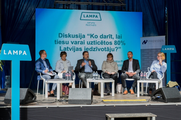 """30.06.2018. What should be done so that 80% of population of Latvia would have confidence in the judiciary? – this was a question asked in one of the discussions of the festival """"Lampa"""" in Cesis, in which also judges of the Supreme Court Aigars Strupiss and Anita Kovalevska participated. Judge Strupiss also serves as a Chair of the Disciplinary Court, and Judge Kovalevska – Chair of the Judicial Ethics Commission."""