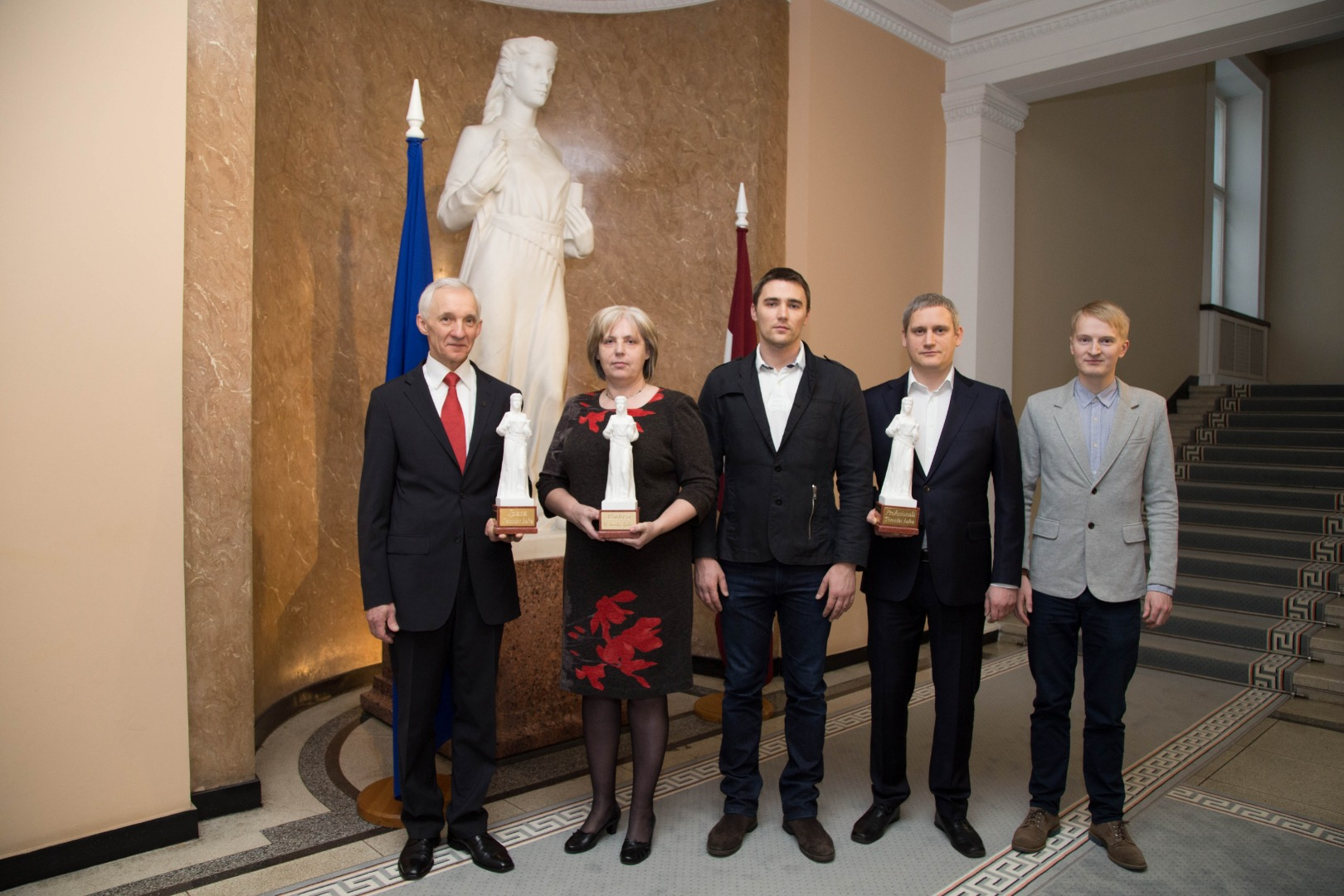 """18.12.2015. Themis Award has new nominations – Professional, Creative and Special. Design of the award was inspired by the sculpture """"Justice"""". Awards were received by Senator Valerijans Jonikans, Head of the Communication Division Rasma Zvejniece, and the IT Division"""