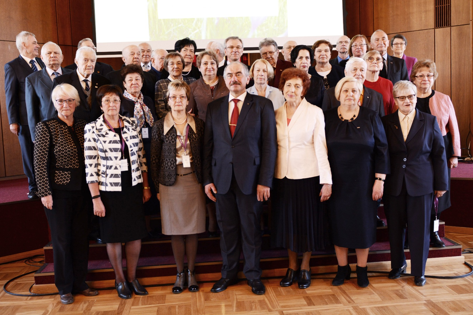 """12.04.2018. The retired employees of the Ministry of Justice, judges, prosecutors, lawyers and notaries were invited to attend the joint event of the judiciary – """"Seniors' Day"""". The seniors were addressed by officials of the judiciary, participants took delight in musical performances of the mixed choir of the Latvian Collegium of Sworn Advocates and watched the movie """"Senators""""."""