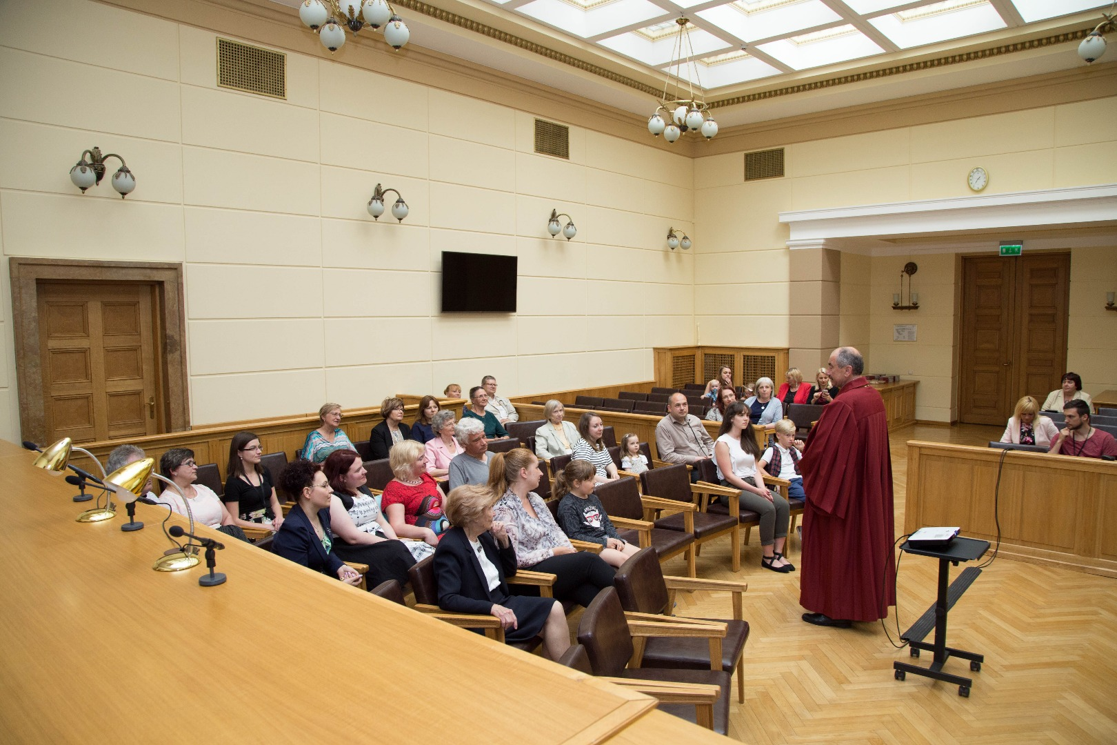 """18.05.2018. On the Day of Families the families of judges and employees – parents, grandparents, spouses, brothers, sisters and other relatives were invited to visit the Court. """"Your support and understanding help your dear ones in their daily work. Therefore, we wish to show where we work and what we do"""", Ivars Bickovics, the Chief Justice of the Supreme Court, said at the opening of the event. Visitors watched the film """"Senators"""", walked around the Palace of Justice, visited the Supreme Court Museum, as well as their relatives' workplaces."""